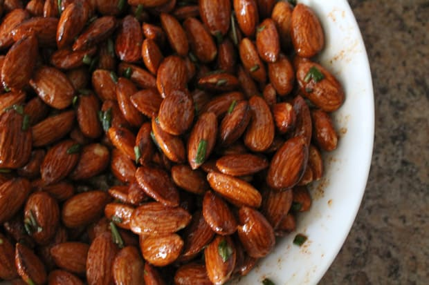 raw almonds in a white mixing bowl