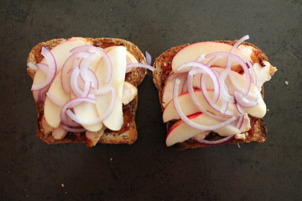thinly sliced apples and onions layered on the toast