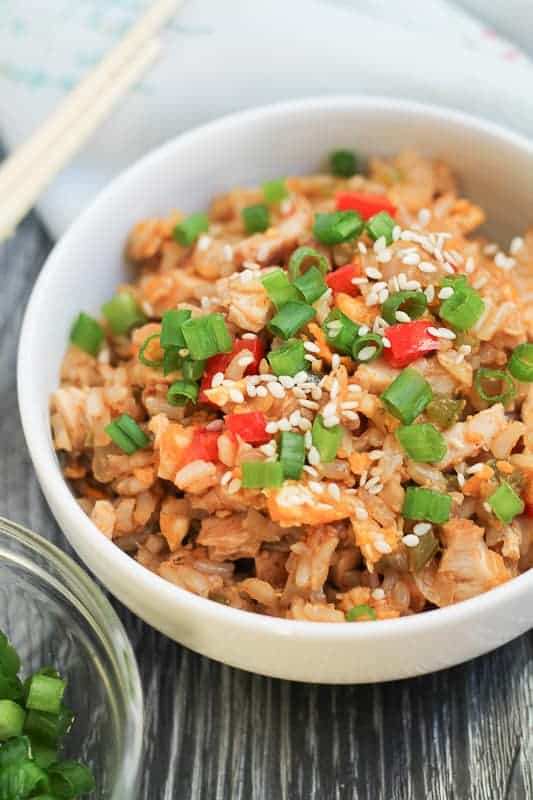 Next time the craving for delivery hits, try this Chicken Fried Brown Rice! A healthy, gluten free dinner recipe that has the bonus of delicious leftovers. #chickenrecipes #healthydinner #glutenfree