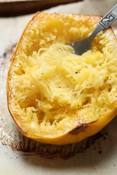 Roasted spaghetti squash being shredded by a fork