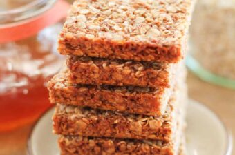 a stack of honey oatmeal squares on a plate