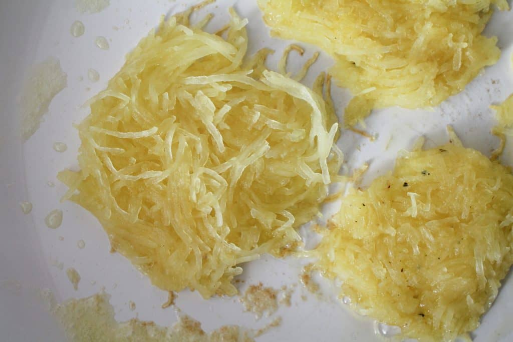 Spaghetti Squash Hash Browns being fried in a pan