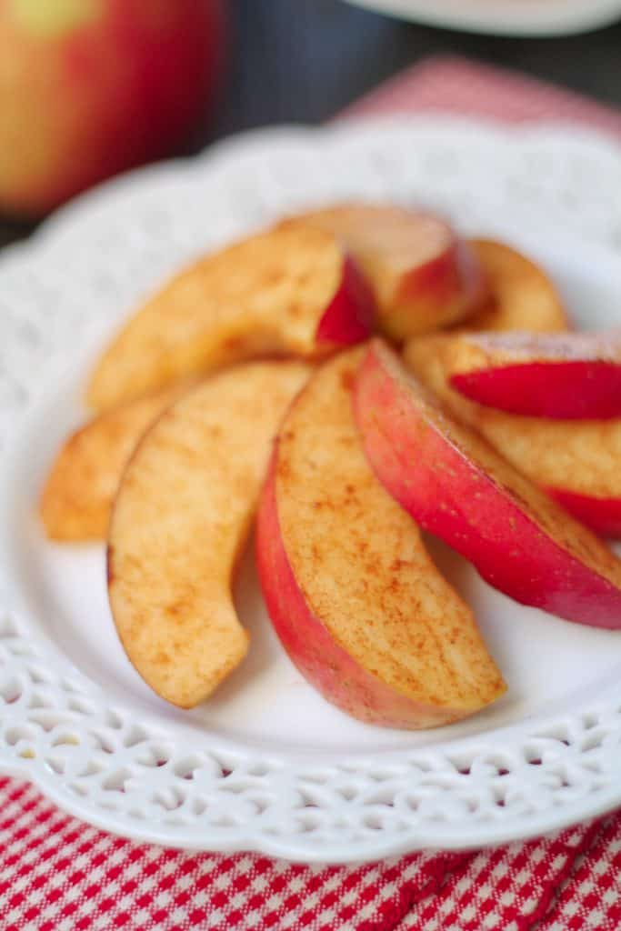 Easy Apple Cinnamon Snacks on a white plate with a checkered napkin in the background
