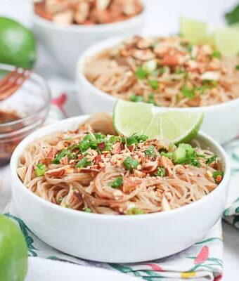 Vegan Pad Thai garnished with fresh limes
