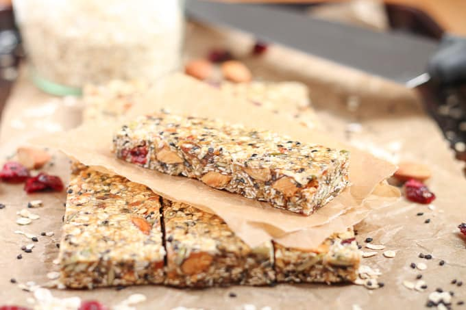 Healthy Fruit Nut and Seed Bars stacked on parchment paper