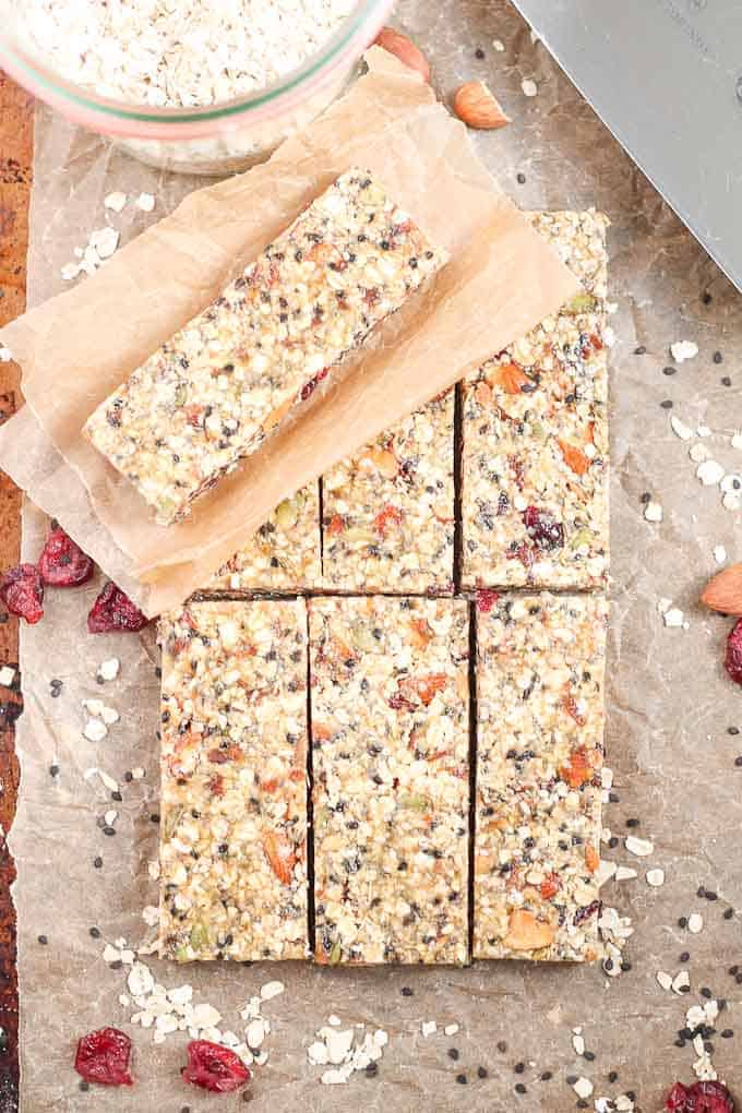 Healthy Fruit Nut and Seed Bars. These delicious granola bars feature dates, cranberries, almonds and almost every seed you can think of! Pumpkin seeds, hemp seeds, chia seeds, sesame seeds, black sesame seeds, this recipe has them all. Naturally sweetened, vegan and gluten free. #healthysnacks #glutenfree #veganrecipe
