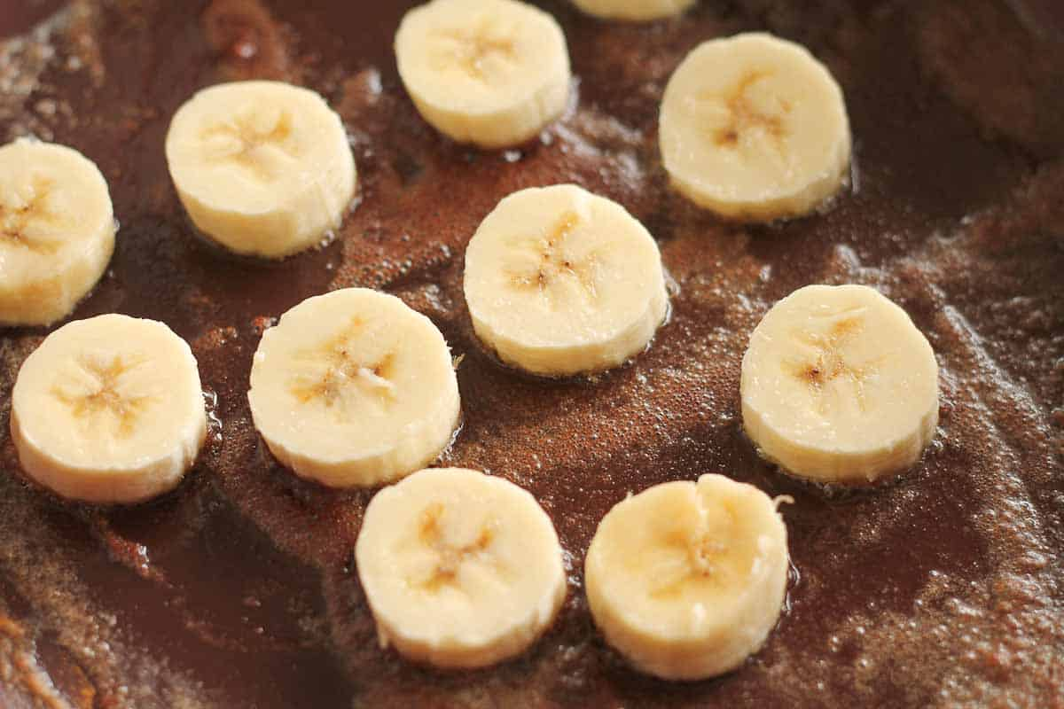 banana slices frying in a pan