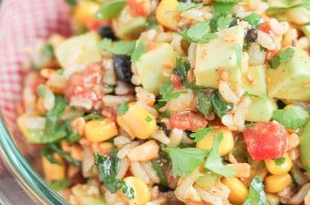 close up photo of cowboy brown rice salad in a glass bowl