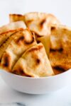 a bowl of crispy homemade pita chips.