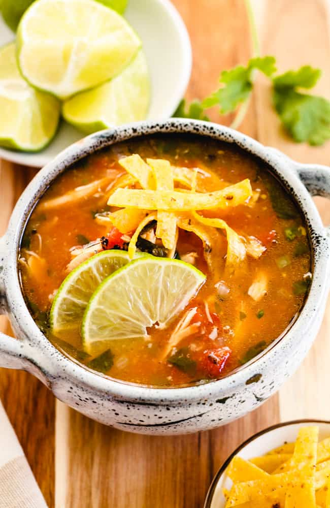 a bowl of chicken lime tortilla soup